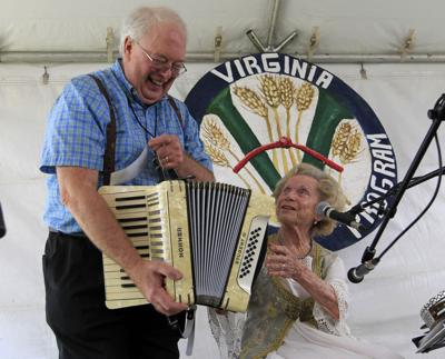 Dale Wise and Flory Jagoda with restored accordion
