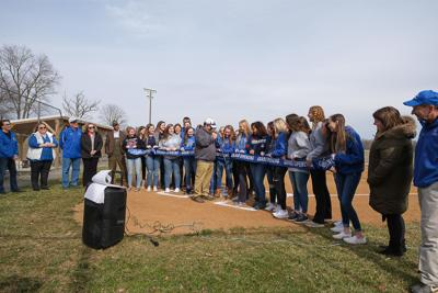 Parks and Rec Director Jerry Carpenter cuts the ribbon at the opening ceremony and dedication of the new high school softball field at Hoover Ridge