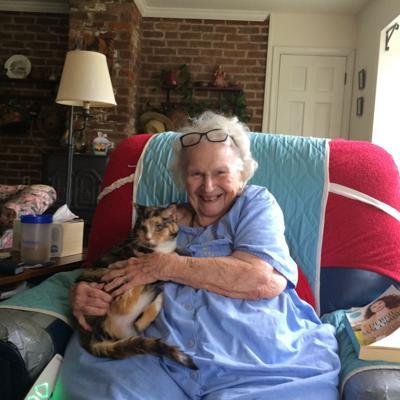 Joella Bradshaw and her cat, Pusser