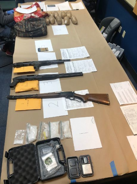 Guns and drugs seized in arrest