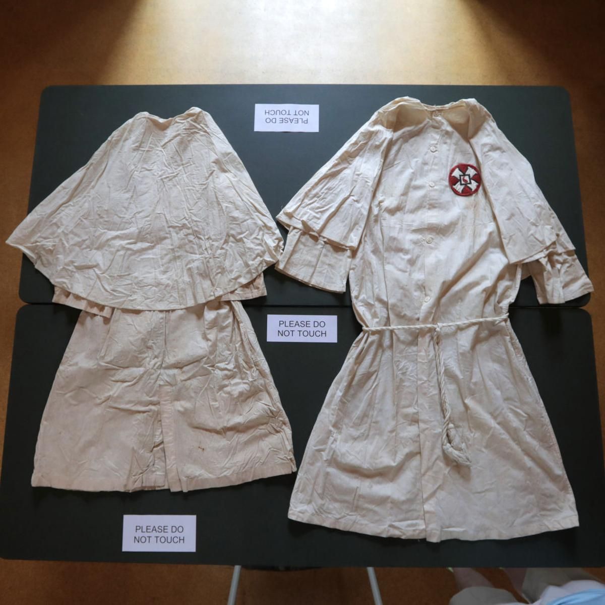 KKK robes unveiled at historical society, but owners kept hidden