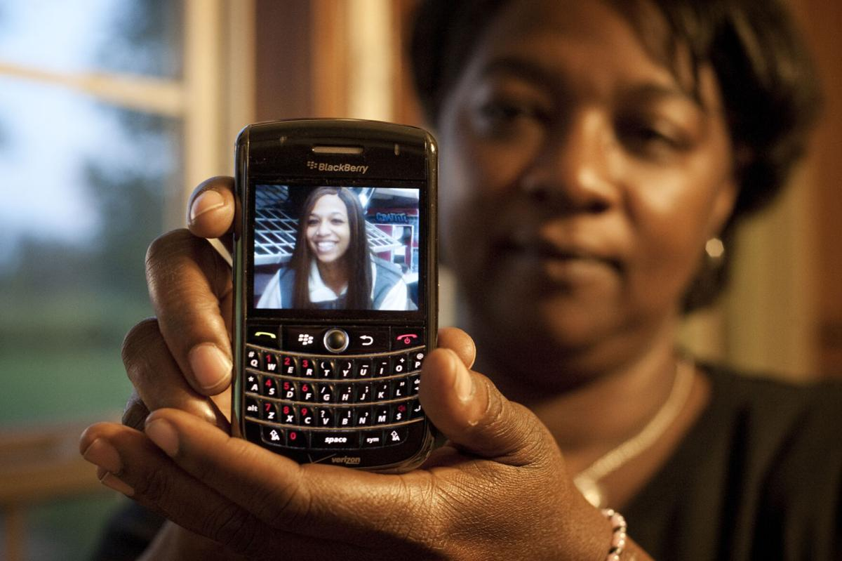 FILE - Laura Murphy, Alexis Murphy's mother, shows cell phone photo