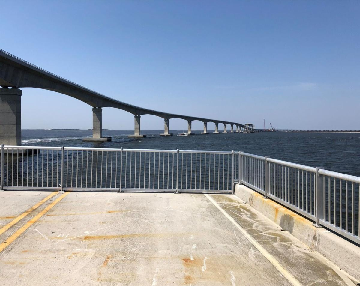 The remains of old Bonner Bridge will become a 1,046 foot-long free fishing pier by this summer. The newer Basnight Bridge spans Oregon Inlet in the background.