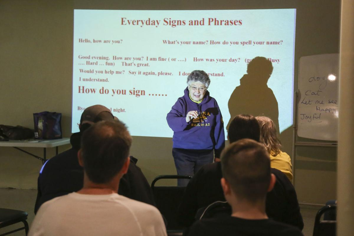 Professor teaching sign language at Augusta County Library