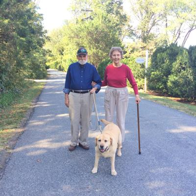 Pets and Their People: Ginger and the Walkers