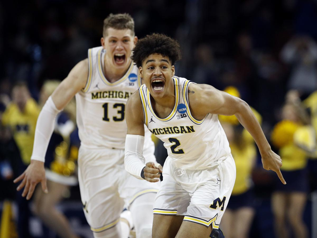 Top pics from Saturday's NCAA action: Michigan wins at the buzzer; No. 11 Loyola-Chicago still alive; and more