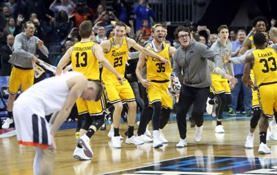 0cb09a36e5ee UMBC players celebrate as Virginia guard Kyle Guy looks down during the NCAA  Tournament game Friday in Charlotte. Virginia lost to UMBC in the first  game.