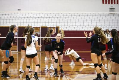 Sarah Bevins (#15) and team celebrate one of Bevins' 10 kills for the match.