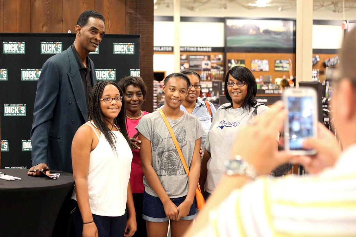 Ralph Sampson greets fans at opening of DICK S Field & Stream
