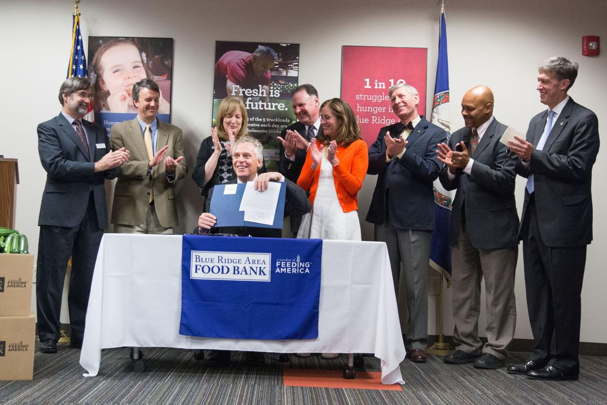 McAuliffe visits Valley, signs bill boosting food banks, farmers