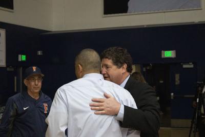 Jim Donovan talks with women's basketball head coach Jeff Harada