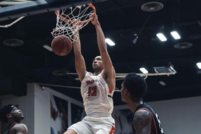Cal State Fullerton's men's basketball dominates in season opener