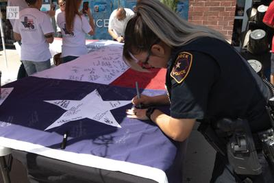 Market Street hosts flag signing for El Paso shooting victims