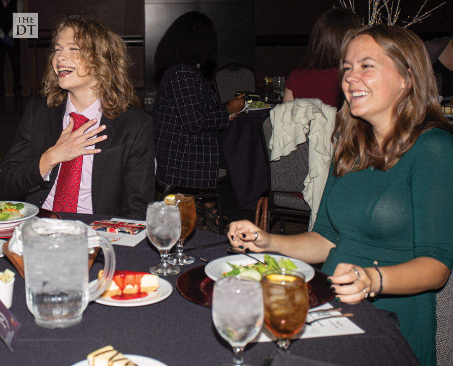 Students enjoy talking to friends at The Boots, Bows & Rainbow Ties Gala