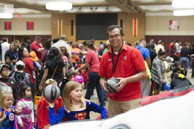 Students volunteer at Tech or Treat event