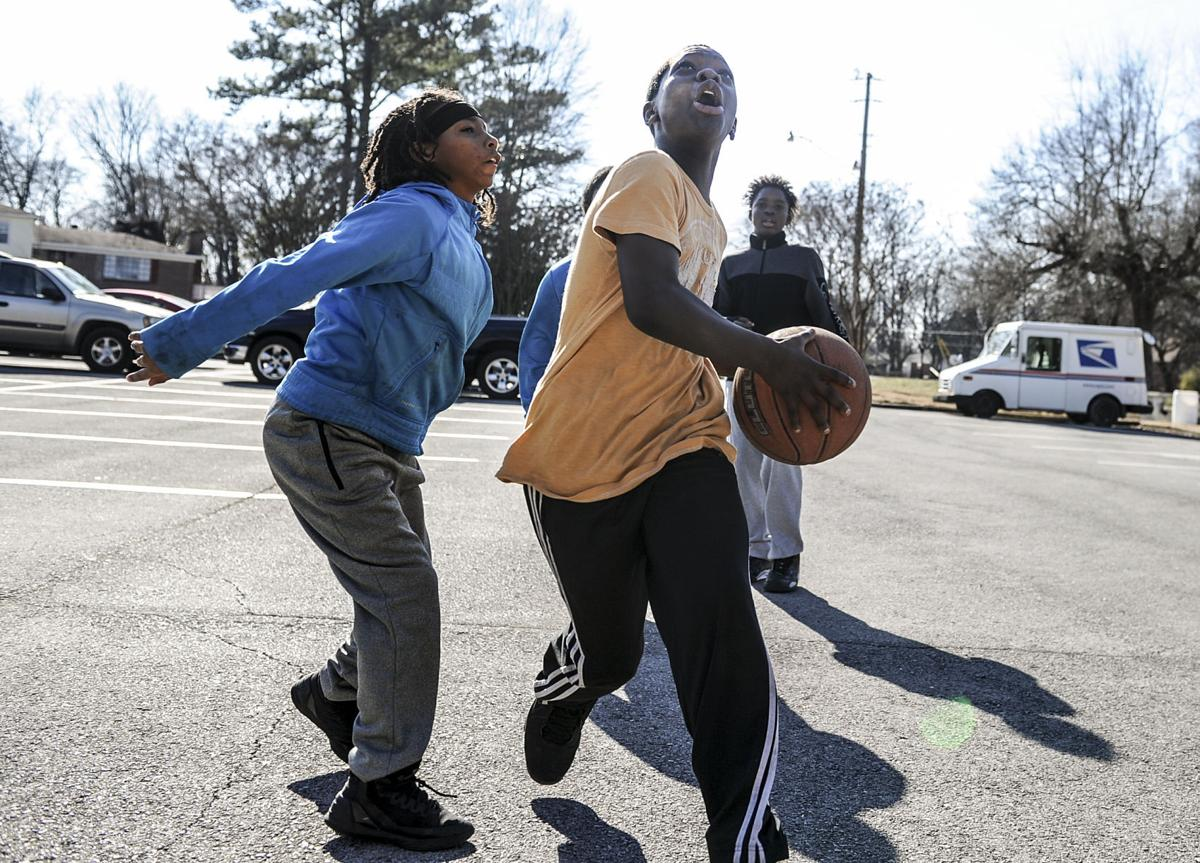 Expanded league keeps older teens off streets decatur - Carrie matthews swimming pool decatur al ...