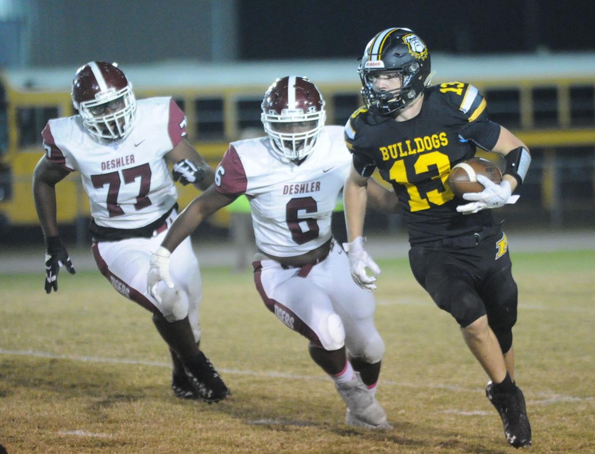 Priceville's Xander Gaines (13) avoids Deshler defenders as he looks for room to run..JPG