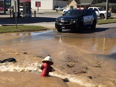 Beer Truck Knocks Over Fire Hydrant Near Dunkin Donuts