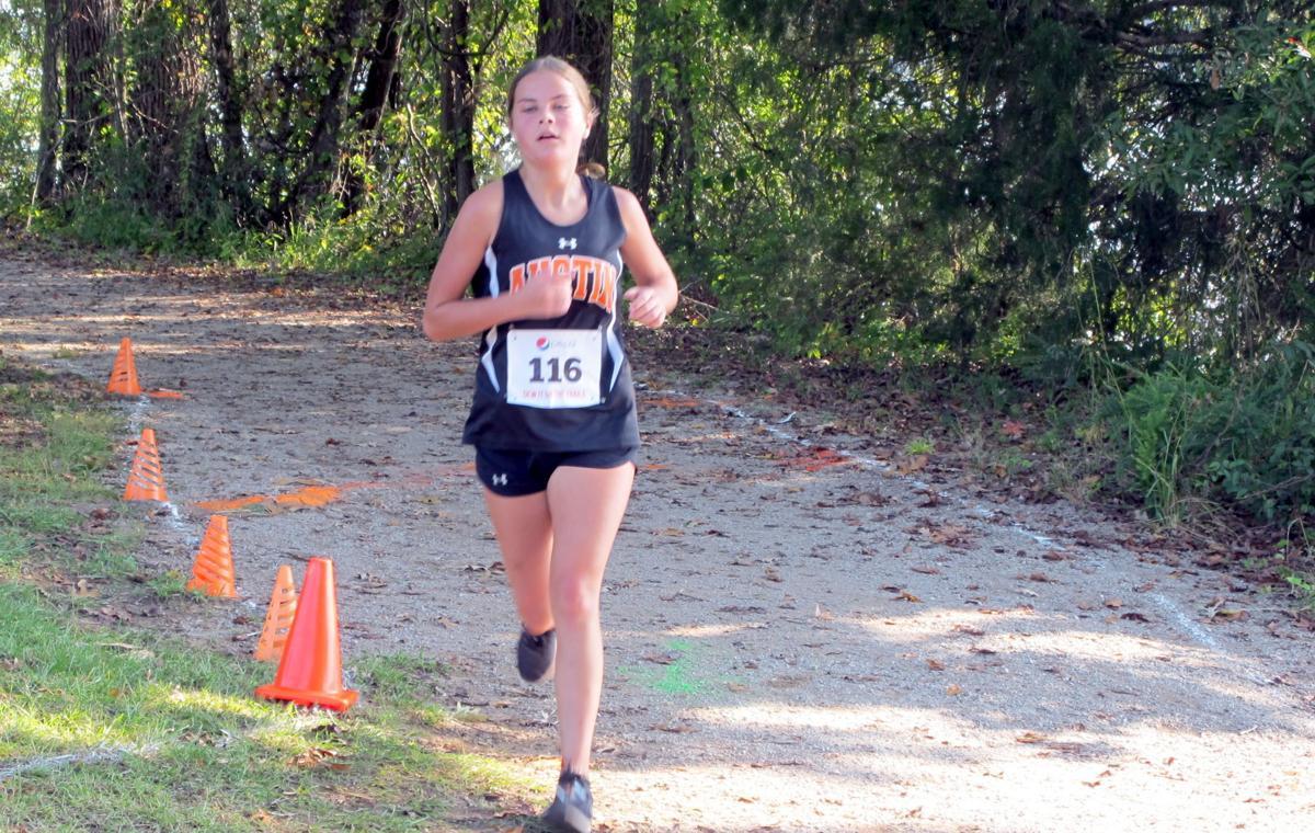 Austin's Anna Motsinger nears the finish line.jpg