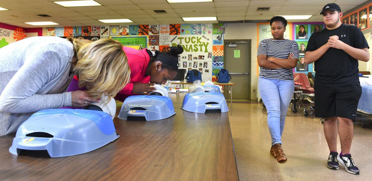 Role Reversal Recent Austin Graduates Help Coaches Get Cpr