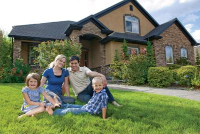 Family On Lawn in Front of House