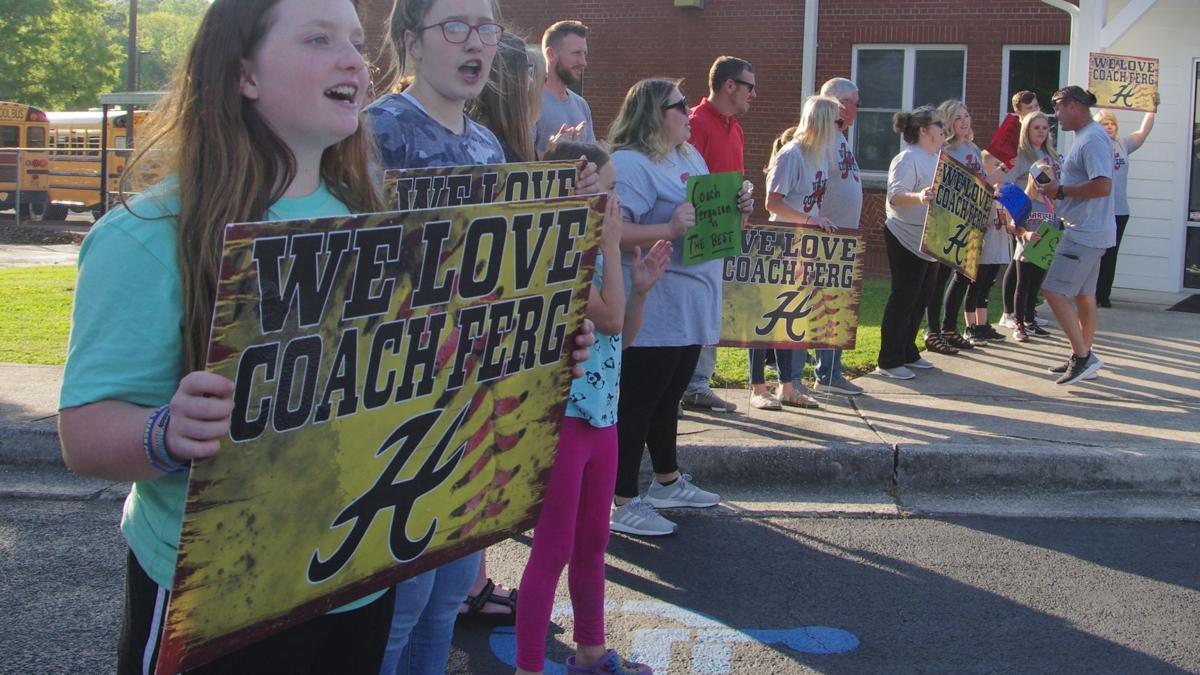 Supporters for ousted coach push school board to reinstate