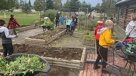 Fifth graders clean gardens