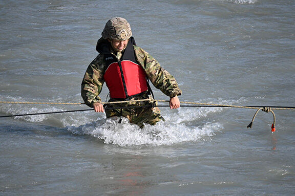 Soldier crossing river