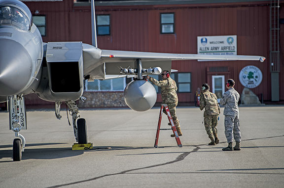 Airman works on F-15
