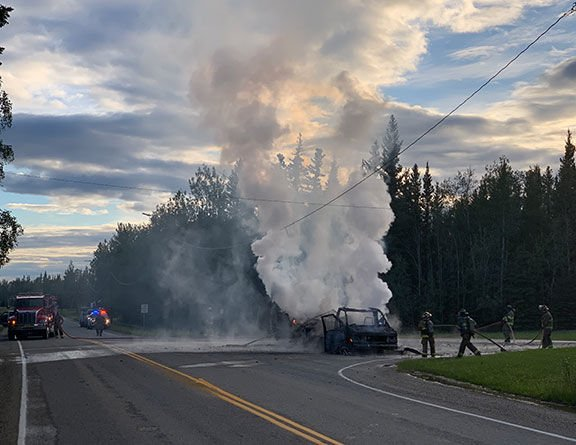 Firefighters Attack RV Fire