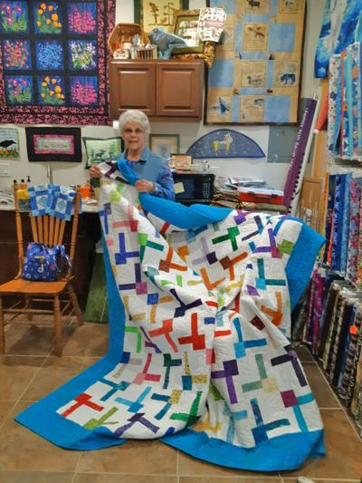 Quilt Raffle Raises Funds for Fire Victims