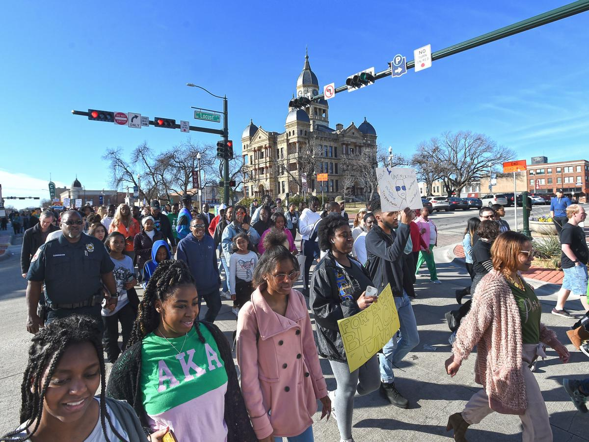 Marchers pass the Square