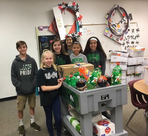 The Lake Dallas Middle School Student Council rolls around a snack and drink cart to classrooms in honor of Teacher Appreciation Week.