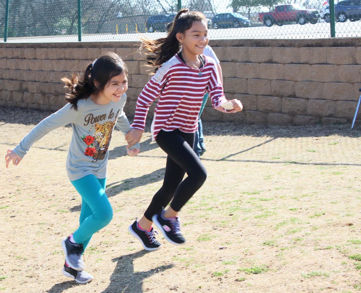 Third-graders running