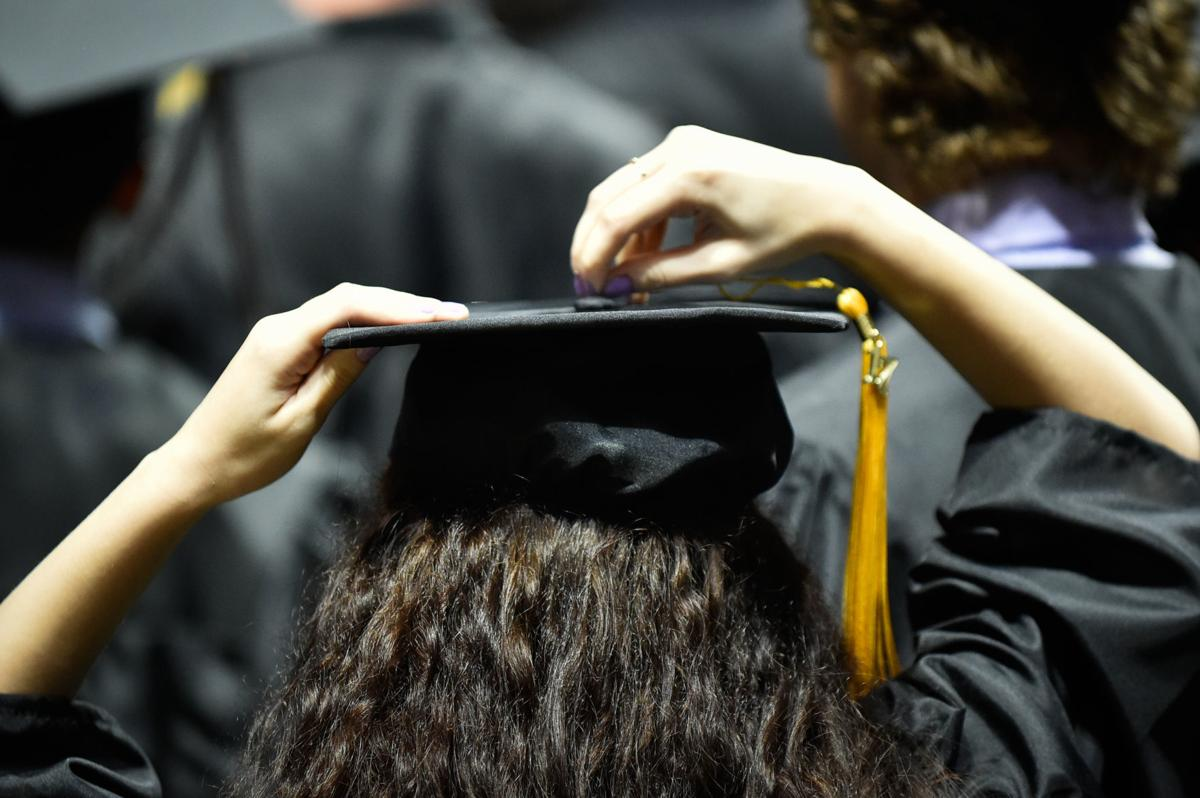 Graduating students turn their tassels during the Guyer High School Commencement Program at the UNT Coliseum
