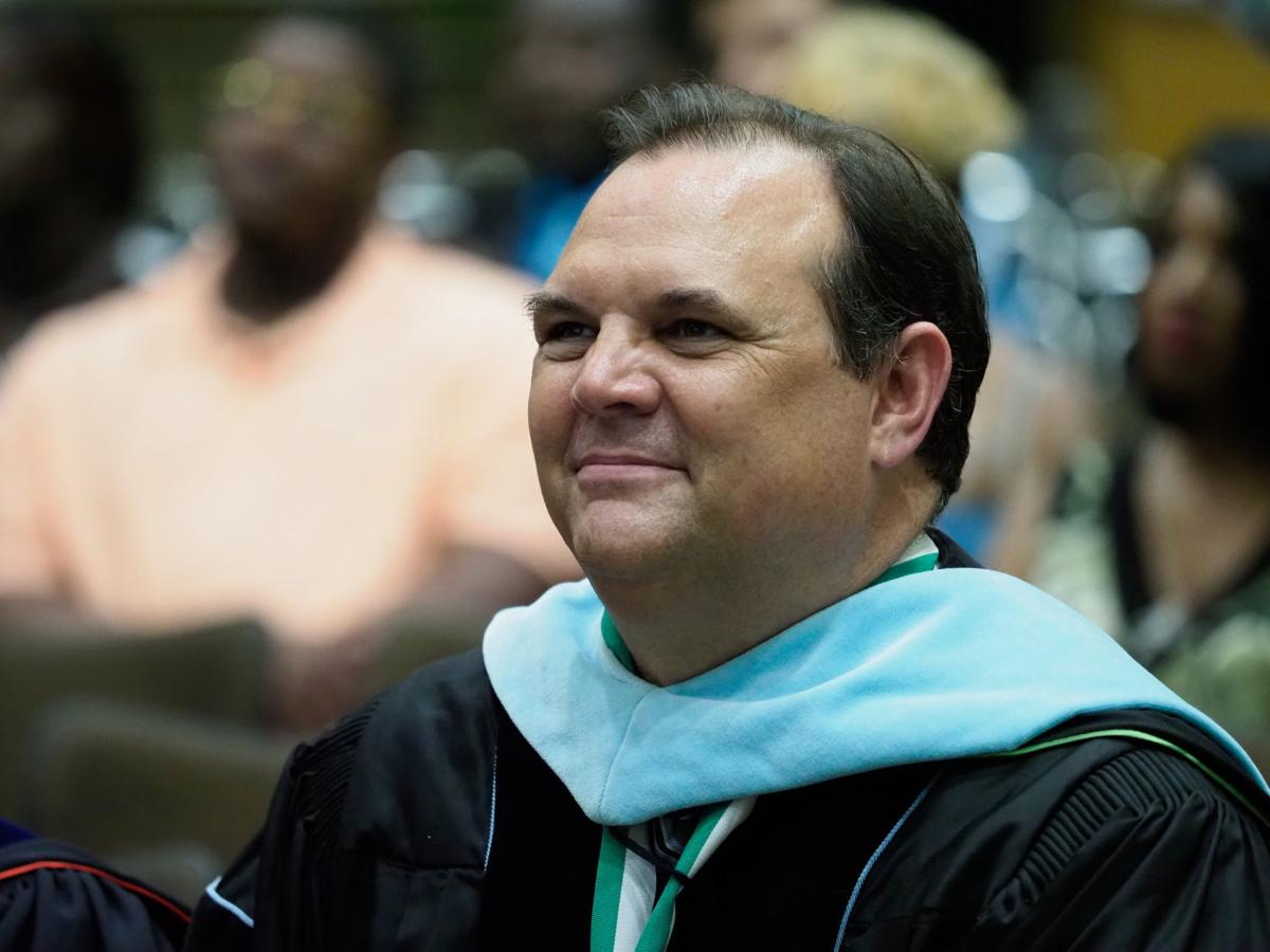Denton ISD Superintendent. Dr. James Wilson, smiles as he watches a photo slideshow of the students during the Fred Moore High School graduation ceremony at the UNT Gateway Center.  Fred Moore High School is Denton ISD's alternative high school program.  T