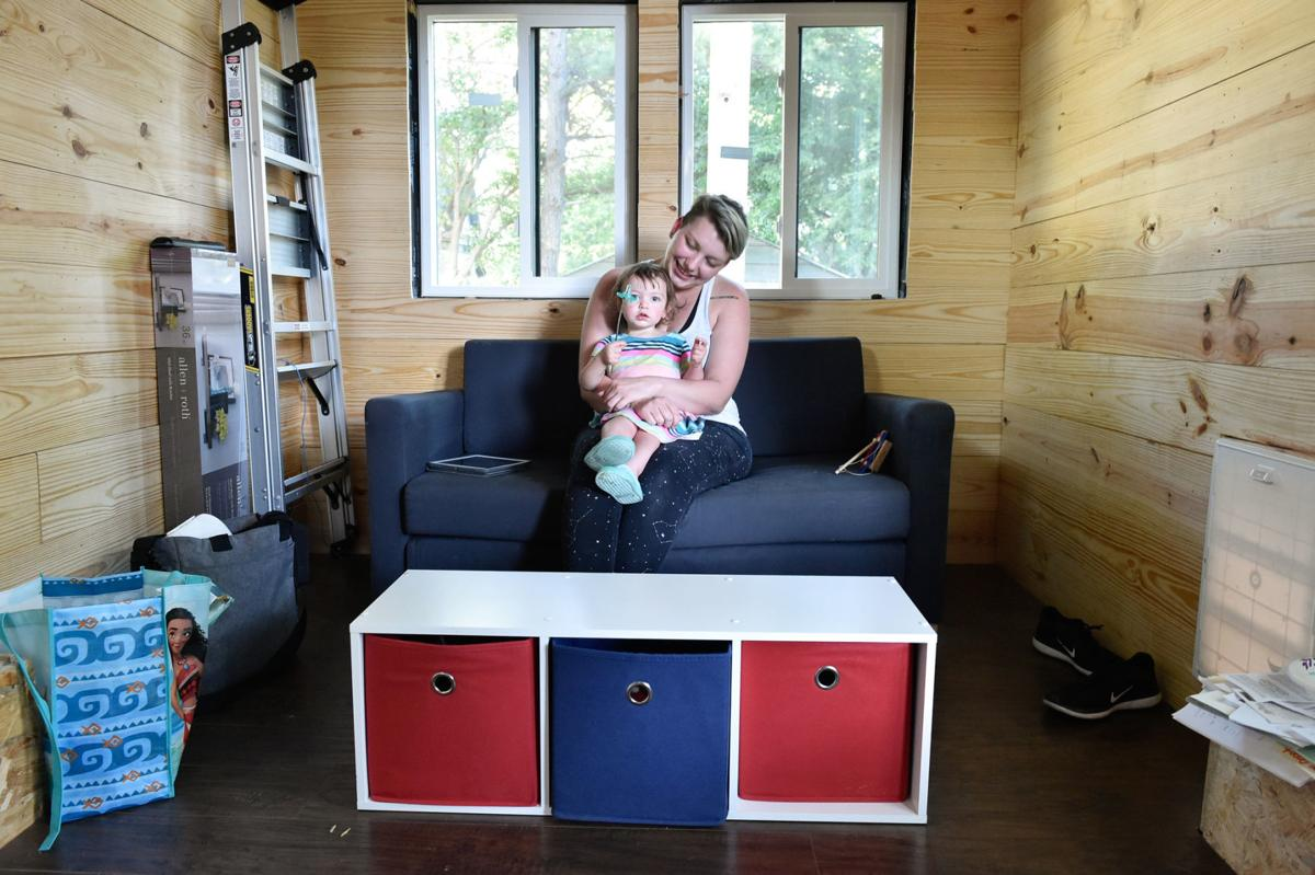 Owner Susan Huerta and her daughter River, sit inside the living room of their tiny house.  Huerta's tiny house is approximately 191 square-feet and took around a year and three months to build.