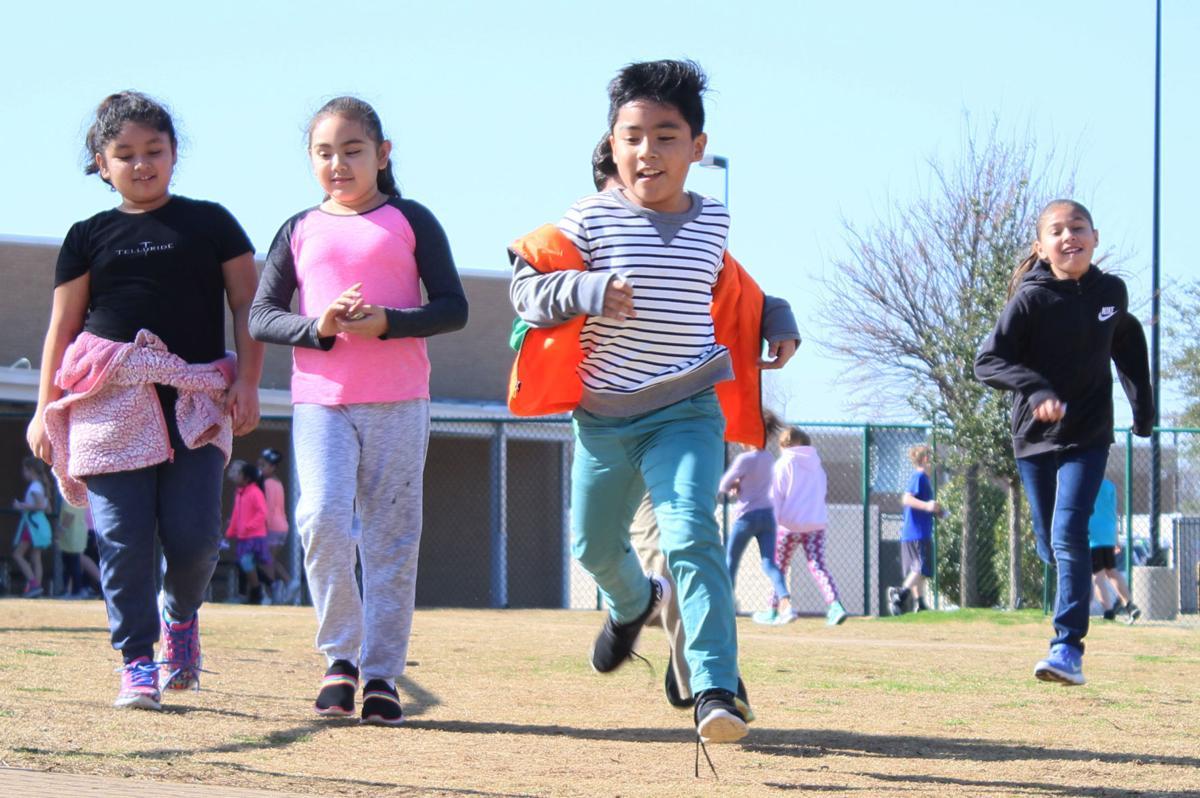 Group of third-graders running