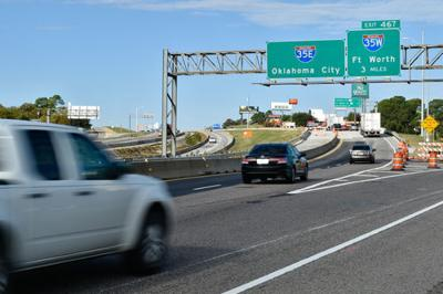 Vehicles travel on Interstate 35E northbound bridge that goes over Dallas Drive.