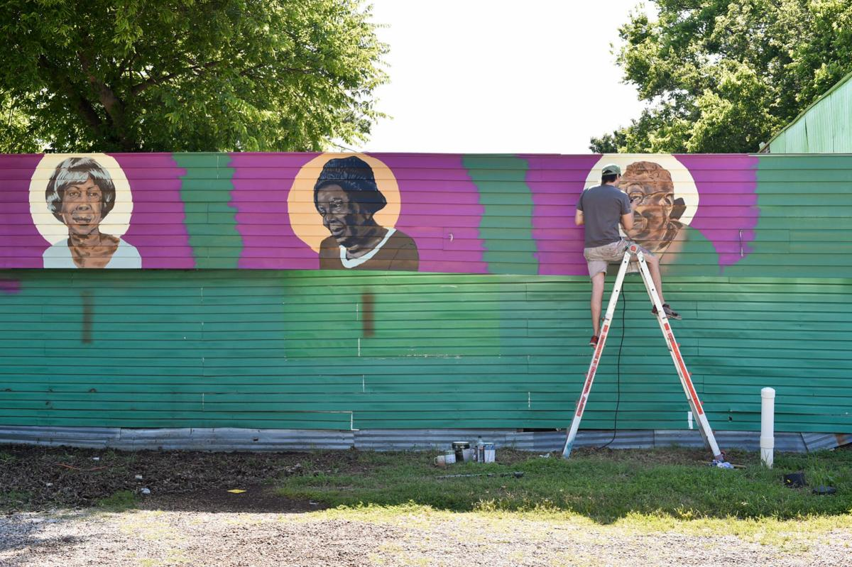 Muralist paints historical piece n local business