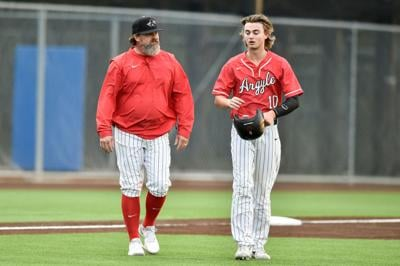 Tyler Grubbs with coach Ricky Griffin