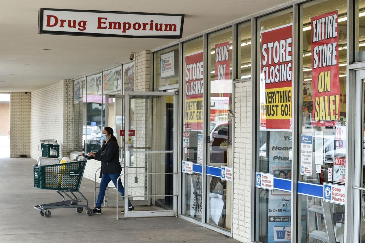 Shopper leaving Drug Emporium