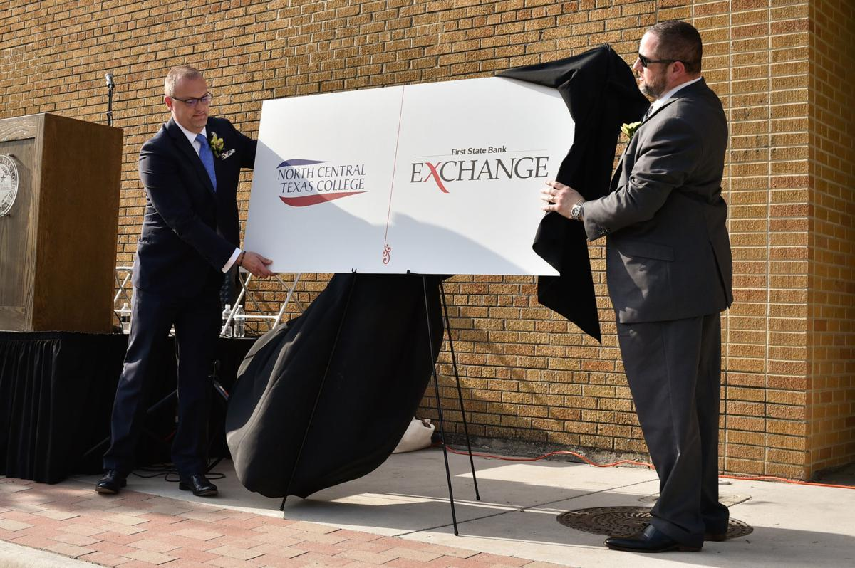 Brent Wallace, NCTC chancellor, left, with Ryan Morris, First State Bank CEO, unveil the name of the college's downtown building called, 'The First State Bank Exchange at North Central Texas College', at the former Denton Record-Chronicle.  North Central T