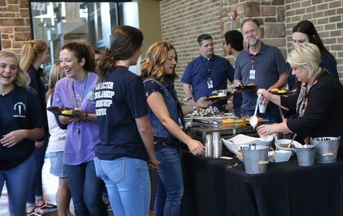 Liberty Christian teachers dig into breakfast provided by the school's National Honor Society for Teacher Appreciation Week.