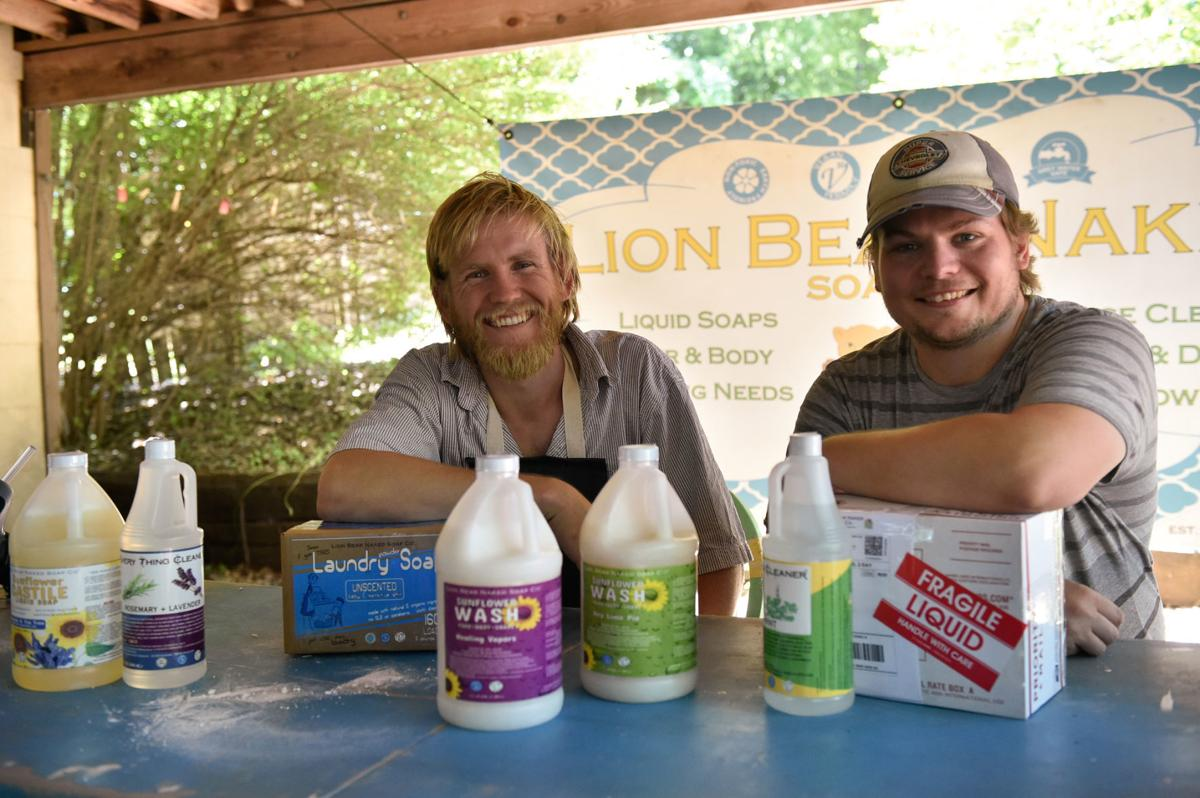 Company associate Chris Klabunde, left, and founder Jason Schreiber, are with some of their soap and cleaning products at Lion Bear Naked Soap Co.  The company manufactures a full line of multi-use soaps, body washes, spray cleaners, and laundry powder. Ev