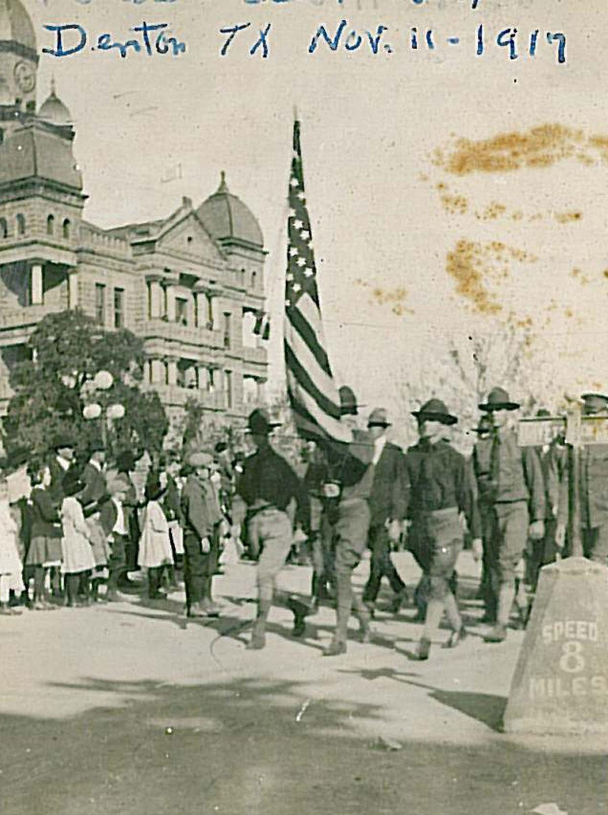 1917 Denton street sign during Armistice Parade