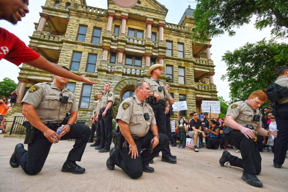 Sheriff's deputies kneeling