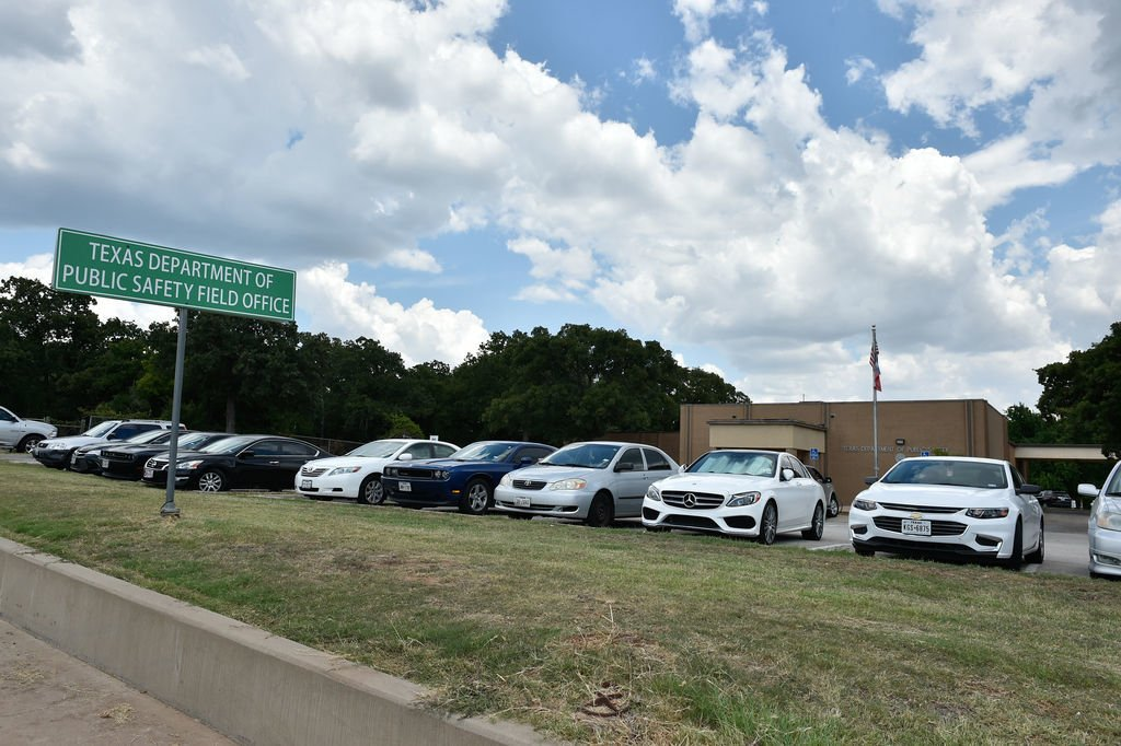 Cars are shown parked at Texas Department of Public Safety Office in Denton. This summer, long waits at the local DPS office triggered an order to limit ...