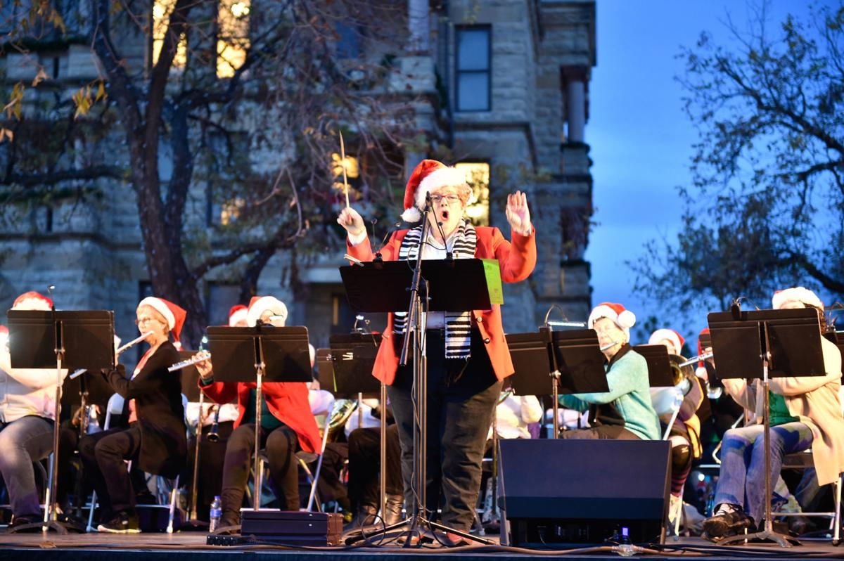 An ochestra performs for the crowd before the Christmas tree is lit during the Holiday Lighting Festival at the Courthouse-on-the-Square.The free festival is held annually and this will be the 29th time it has been held.  Guests enjoyed many fun activiti