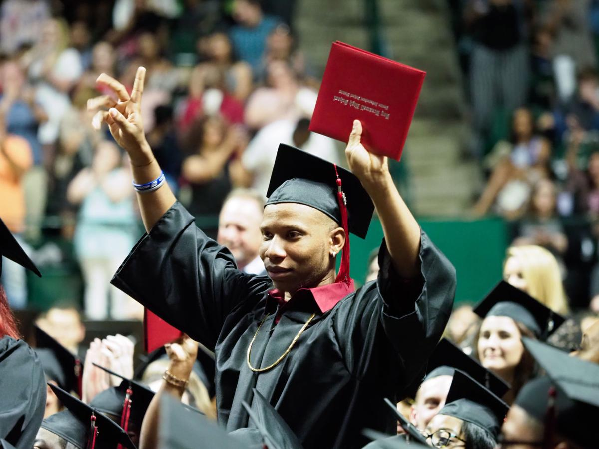 Graduating students celebrate after they receive their diplomas during the Braswell High School graduation ceremony at the UNT Coliseum.  This is the first graduating class from the school
